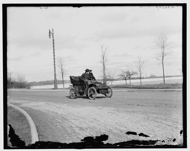[Automobile on road by waterfront]