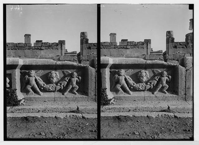 Baalbek. Temple of the sun. Cherubs and festoons on basin in court of altar