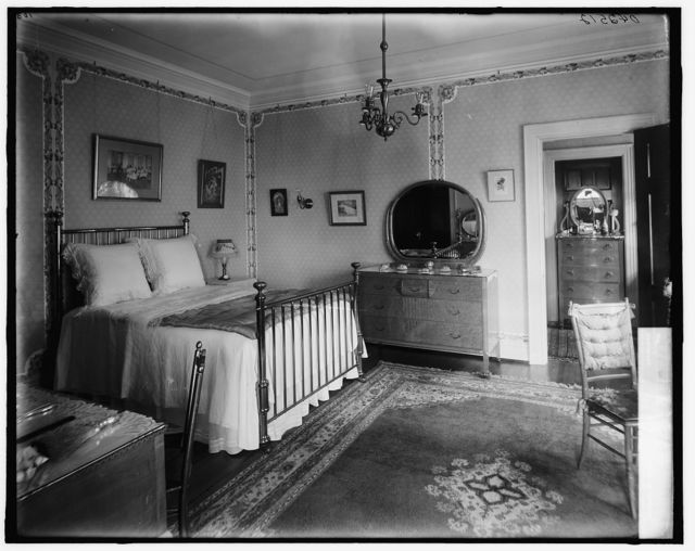[Bedroom with brass bed]