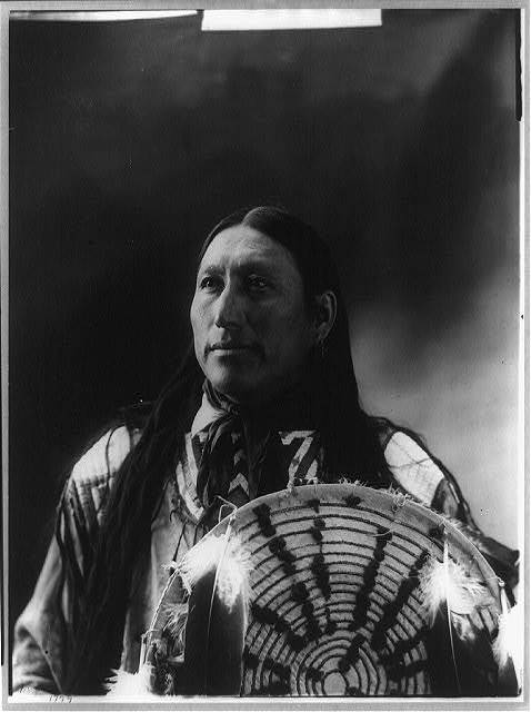 [Big Man, half-length portrait, facing front holding decorated shield]