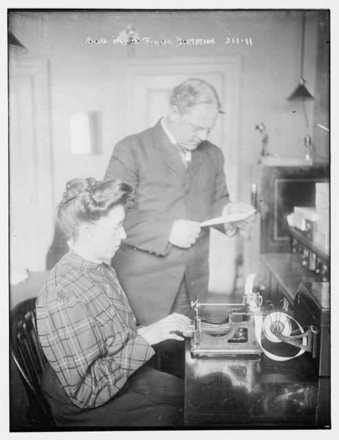 Blind women taking dictation on machine