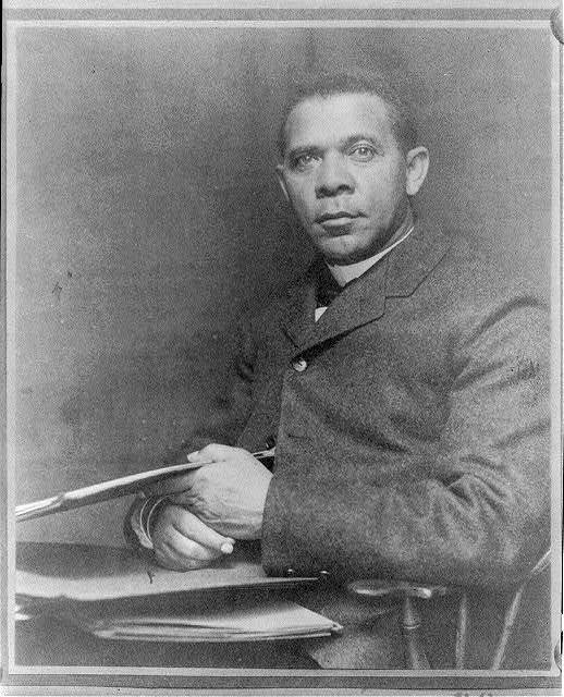 [Booker Taliaferro Washington, seated, facing left, with papers]