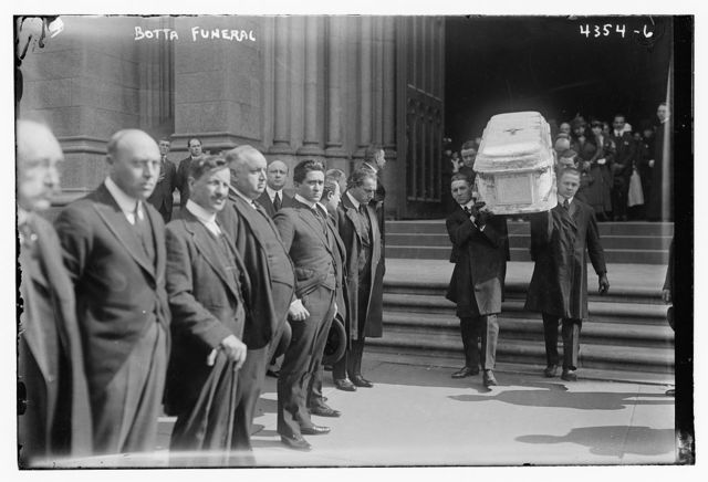 Botta funeral  [carying coffin from church]