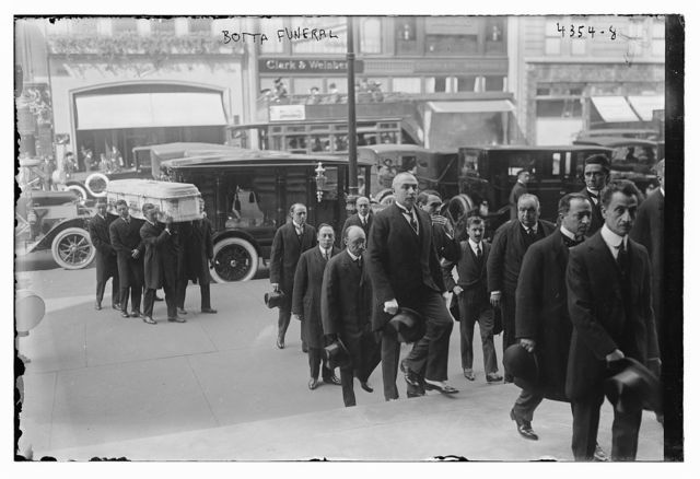 Botta Funeral  [procession crossing street]