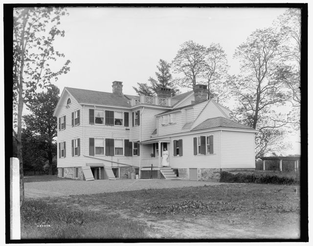 [Calloway residence, back, showing porch with woman, Mamaroneck, N.Y.]