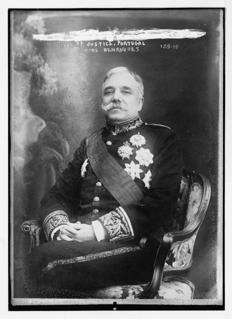 Campos Henriques, Minister of Justice, Portugal, seated, in uniform