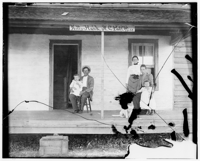 [Captain William J. Tate, the Wrights' first host in Kitty Hawk, and family on porch of their home, the Kitty Hawk Post Office]