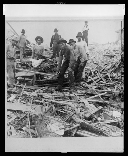 Carrying out bodies just removed from the wreckage, Galveston