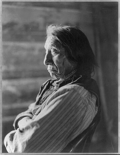 [Chief Red Cloud, bust portrait, facing left, arms folded]