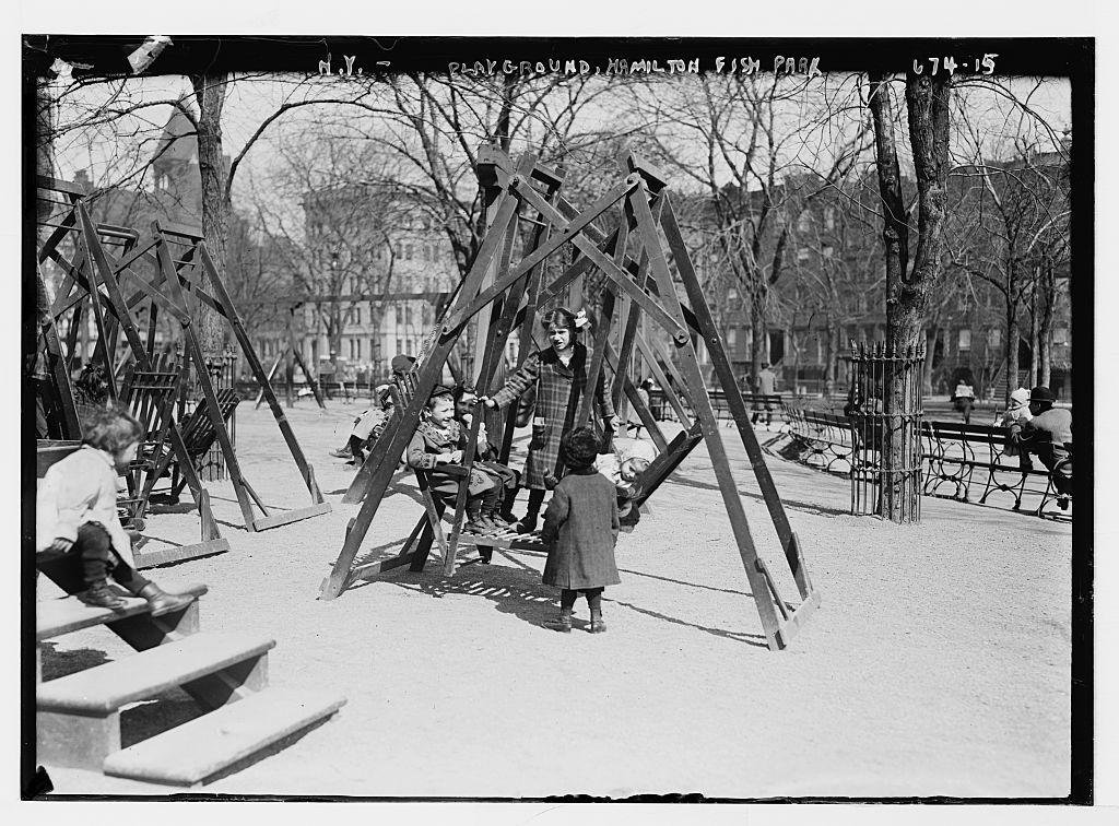 Children in playground swings, Hamilton Fish Park, New York