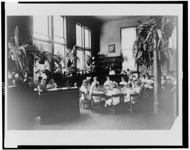 [Children seated in clasroom at a circular table, Sacramento, California]