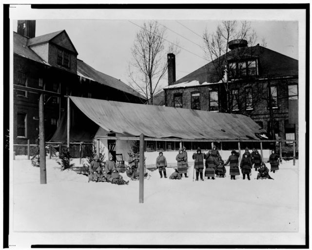 [Children, some with sleds, outside in snow, in front of open-air school, Rochester, New York]