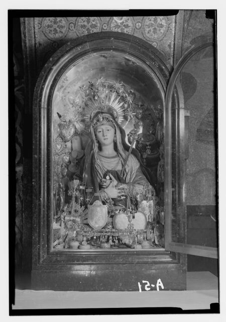 Church of the Holy Sepulchre and surroundings. Statue of the Virgin bedecked with jewels