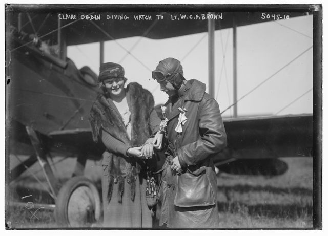 Claire Ogden, giving watch to Lt. W.C.F. Brown