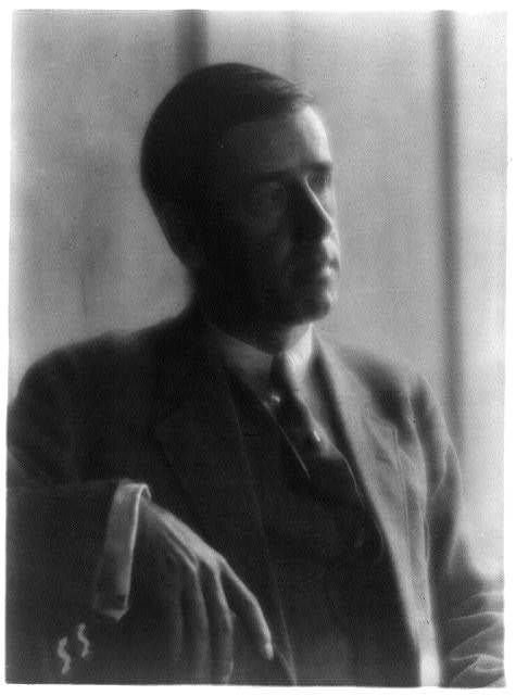 [Clarence White in suit, seated]
