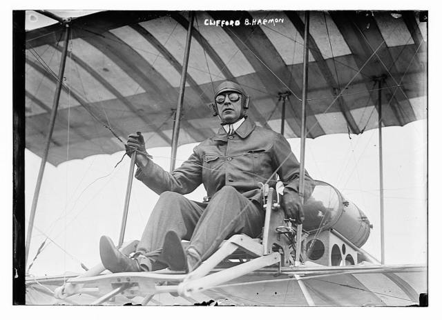 Clifford B. Harmon. Seated in airplane.