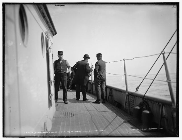 Commissioner Young and pilots on steam pilot boat New York