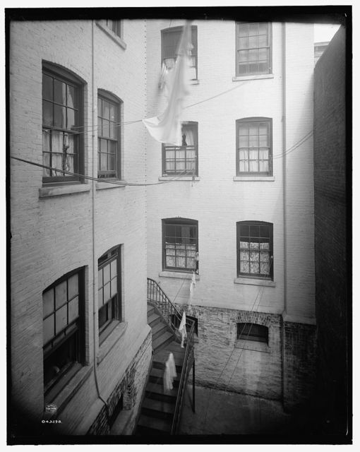 [Court of tenement, New York City]