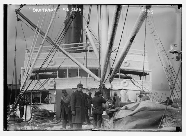 Crew on deck of Orotava, ice clinging to her