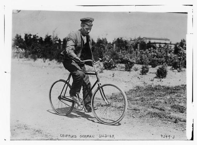Crippled German soldier [on bicycle]
