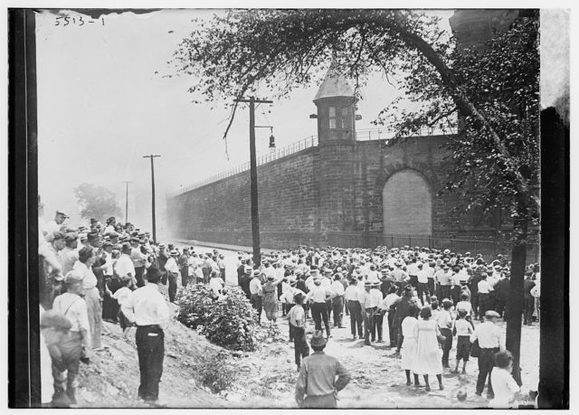 Crowd outside prison, penitentiary outbreak
