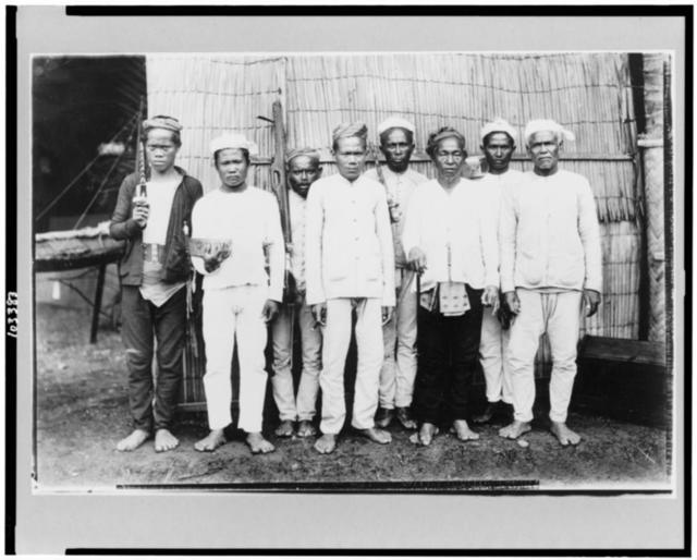 Datto Piang (with cane) and some of his officials
