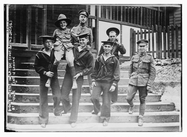 "Digby Morton, Phila. Boy Scout, and U.S. Jackies at ""Eagle"" hut in London"