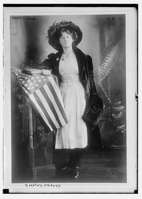 Dorothy D. Frooks standing at flag-draped dais