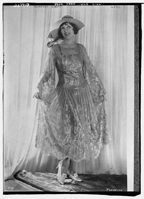 Dorothy Knapp wearing gold brocade over blue