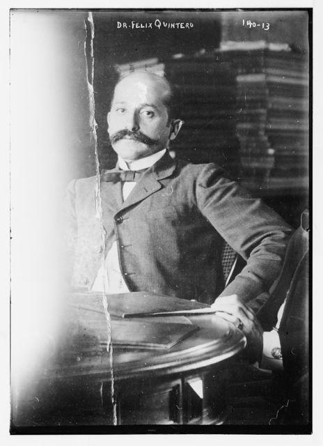 Dr. Felix Quintero, sitting