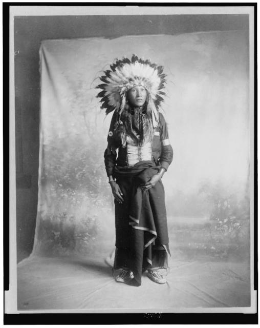 [Eagle Shirt, Sioux Indian, full-length portrait, facing slightly right, standing in front of studio backdrop]