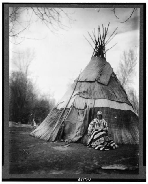 [Edna Kash-kash, Yakima or Umatilla Indian, from Oregon, full-length portrait, seated in front of tepee, facing front]