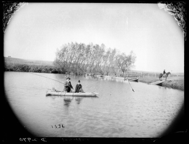 Ephiram Swain Finch and his wife, Sarah, fishing for carp on a pond on Milldale Ranch near Arnold, Custer County, Nebraska