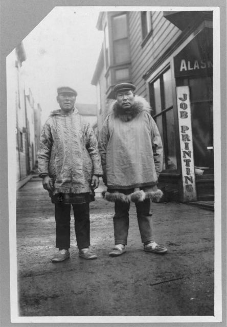 [Eskimos outside shops, on a commercial street in Nome]