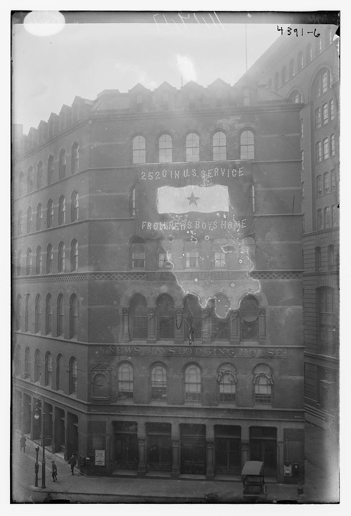 """[Exterior of building with banner reading """"2520 in U.S. service from News Boys Home]"""