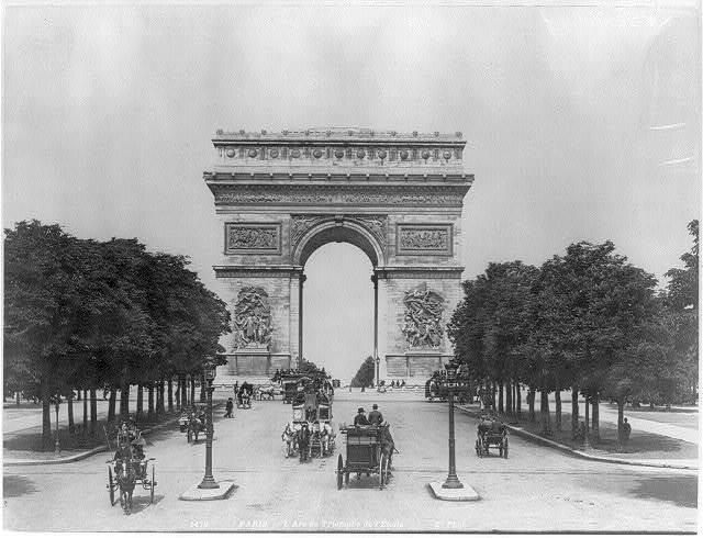 [France - Paris - L'Arc de Triomphe de l'Etoile; variety of horse-drawn vehicles on Champs Elysee]