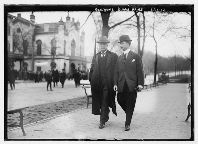 Gen. Hains and Major Hains, walking outside courthouse, Flushing, N.Y.