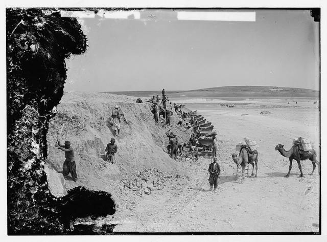German Baghdad Railway, 190_. Digging into hillside and hauling soil by camels and handcar