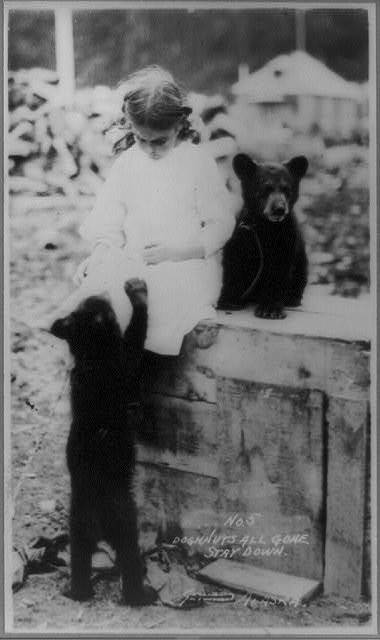 Girl with bear cubs