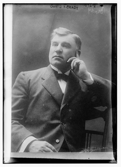 Gov. J.H. Brady seated