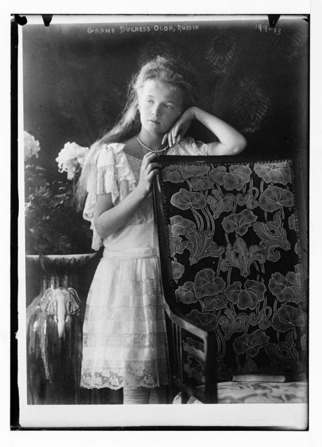 Grand Duchess Olga, leaning against chair