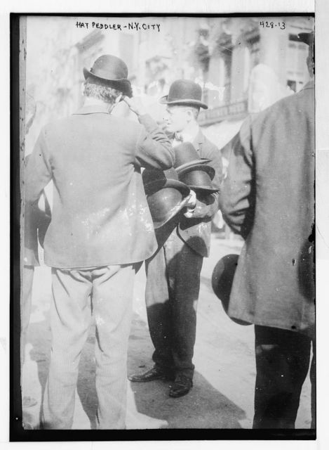 Hat Peddler on sidewalk, New York