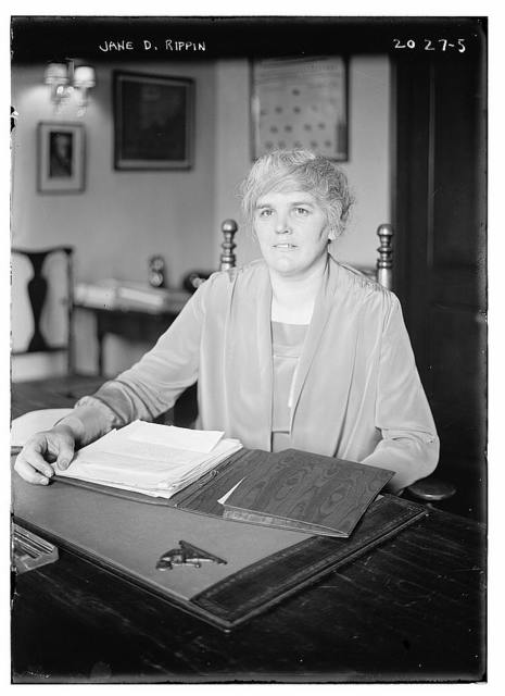 Jane D. Rippin. Seated at desk with papers before her.