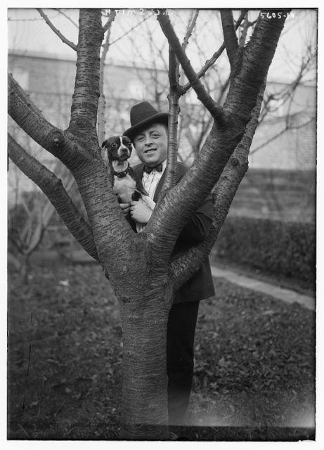 J.C. Smith [holding dog]