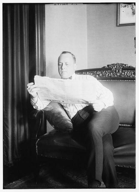 J.C. Smith [reading newspaper]