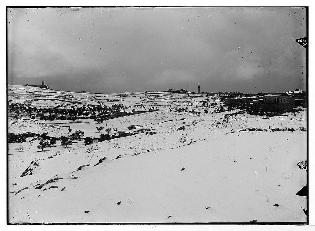 Jerusalem during a snowy winter. Mount of Olives robed in winter garb