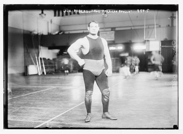 "Joe Rogers, posing as ""The America Apollo"", in gymnasium"