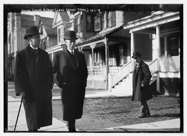 Judge Crane and Chief Clerk during Hains trial, on sidewalk, New York