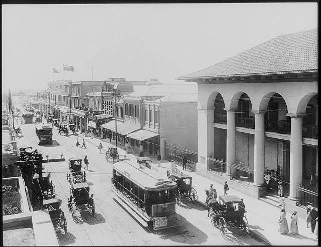 [Kingston, Jamaica, and vicinity: street scene; trolleys]