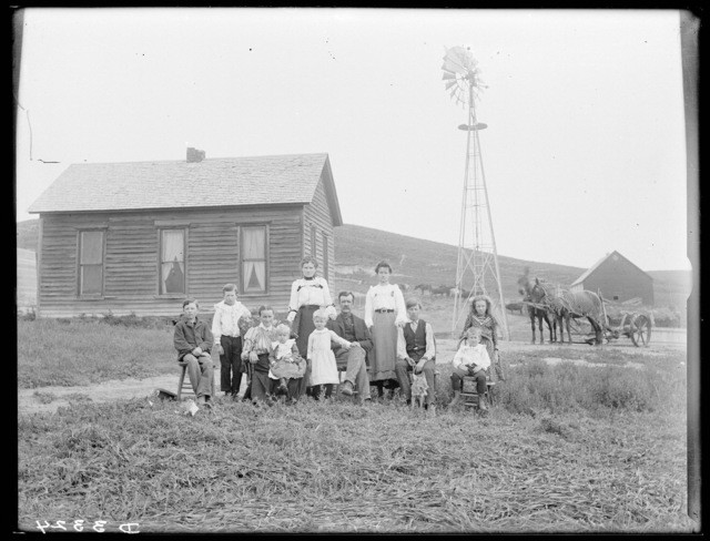 Large family in front of a frame house in Cherry County, Nebraska.
